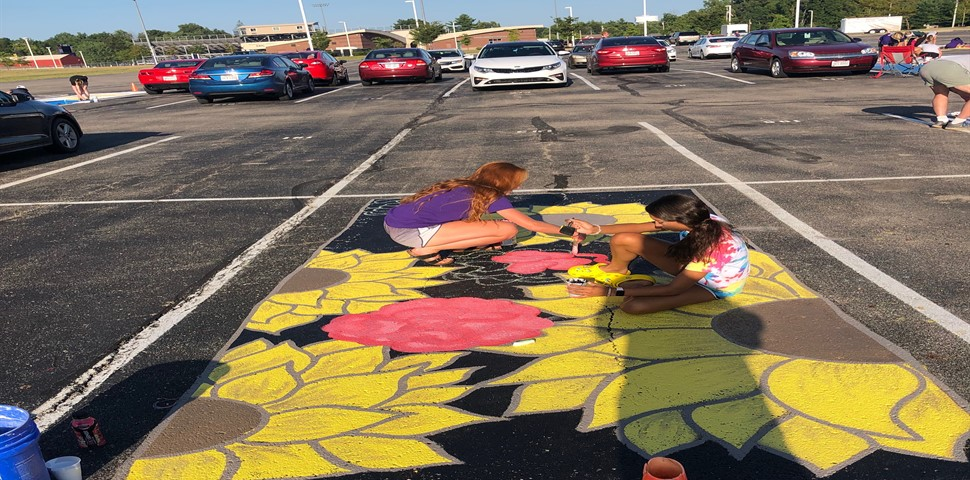 HS STUDENTS PAINTING THEIR PARKING SPOTS
